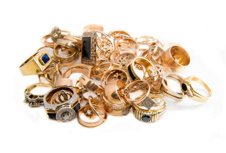 heap of gold jewelry isolated on a white background Stock Photo