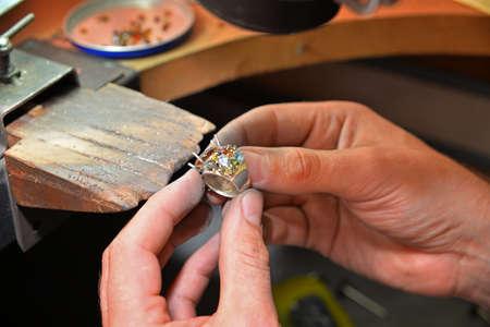 diamond: jeweler fixes gems on gold product
