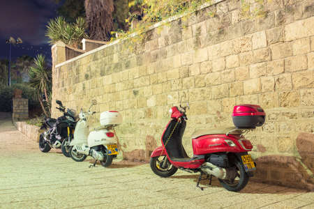 mopeds: TEL AVIV, ISRAEL - JUNE 4, 2015: Mopeds parked at night in the old town Editorial