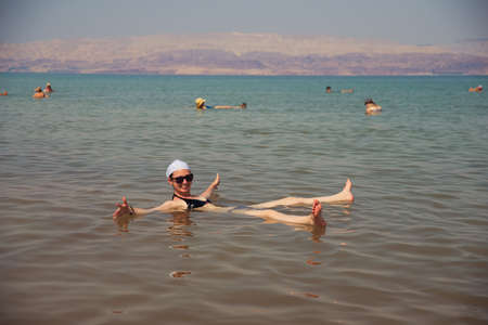 girl bathing in the Dead Sea