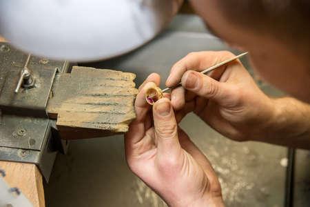 jeweler makes a piece of jewelry