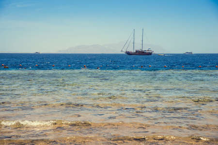 ship in the Red Sea on the background of the island Tran Banco de Imagens