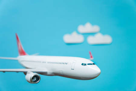 white airplane on a blue background. airplane model