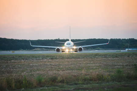 airplane preparing to take off from the airport at sunset