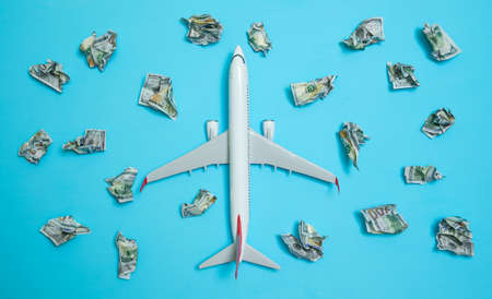Plane on a blue background among the commemorative money