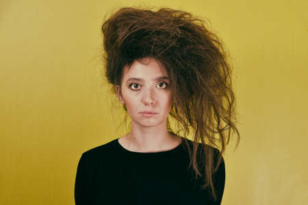 girl with a strange hair style on a yellow background