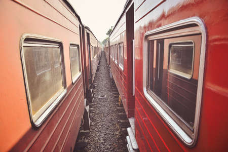 two old red train near Imagens