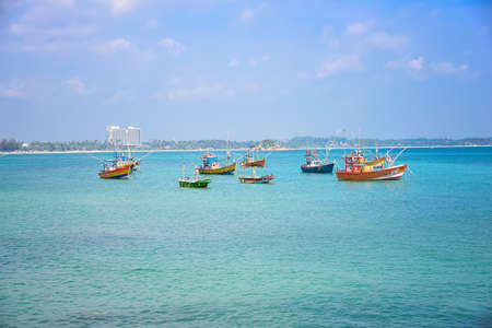 Colorful fishing boats in the harbor waiting for fishermen.