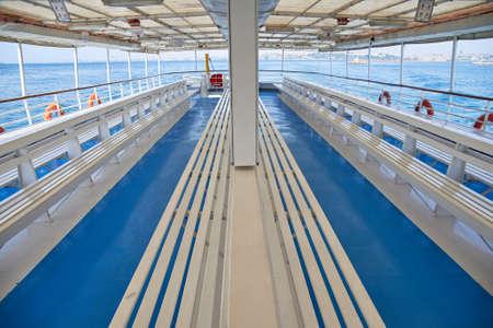 An empty passenger blue ship