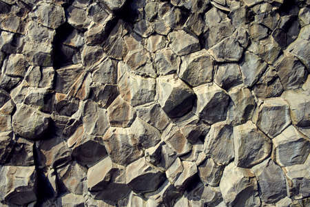 Basalt stone columns close-up on Reynisfjara black beach Imagens