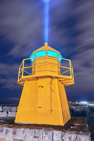 Lighthouse and Imagine Peace Tower on Videy island in Reykjavik at night