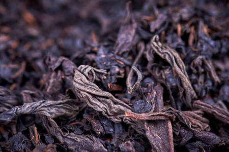 leaves of black dry tea, closeup