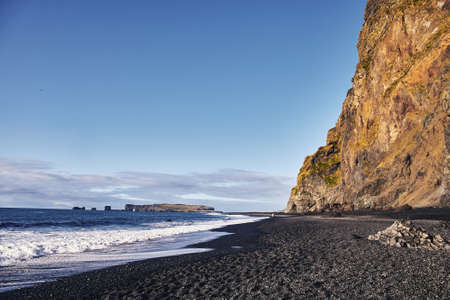 view of the shore with black sand in Iceland