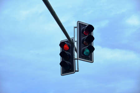 two traffic lights against the blue sky Archivio Fotografico