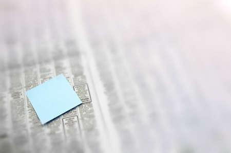 listings: Post-It note in newspaper