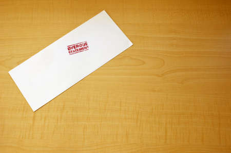 Overdue - blank envelope laying on table Stock Photo