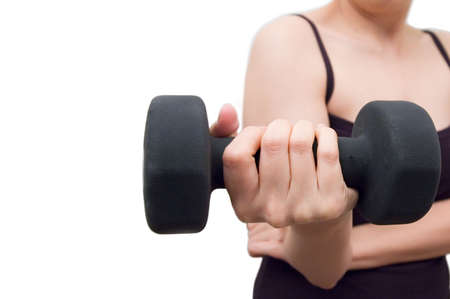 Young woman working out with dumbell Stock Photo