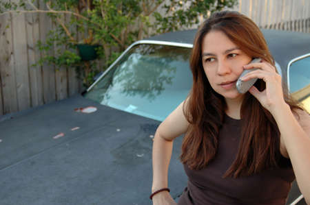 Young woman talking on cell phone photo