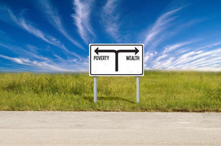 path to wealth: Road sign showing the directions to poverty and wealth Stock Photo