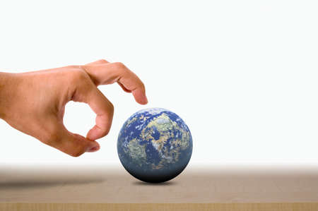 flicking: a Male hand flicking the earth on a wooden surface