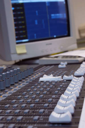 Audio Mixer - with audio computer in background - shallow depth of field photo