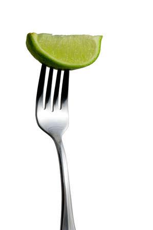 lemony: Lime on Fork over white background