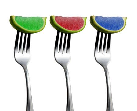 lemony: RGB Limes - colored limes on forks Stock Photo