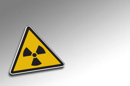 Radioactive warning sign over gradient background - including clipping path for the warning sign photo