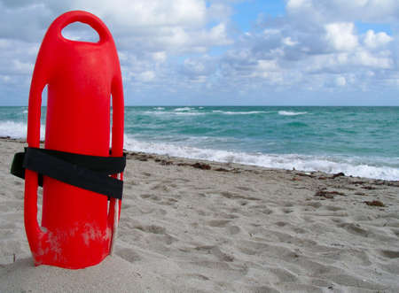 buoyancy: Buoyancy aid sticking in the sand ready for use.