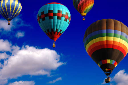 hot colors: Hot Air Balloons racing in the sky Stock Photo