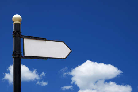 choose a path: Blank sign showing into right direction in front of blue sky Stock Photo