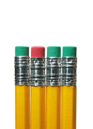 Four pencil erasers - red eraser between green erasers photo