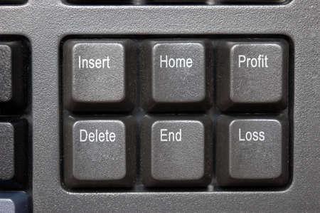 perdidas y ganancias: De p�rdidas y ganancias - cerca de teclado mostrando una clave para cada uno de P�rdidas y Ganancias