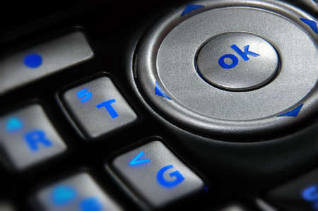 Close up on key pad of a cell phone with focus on 'OK' button Stock Photo - 1132861