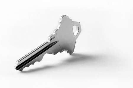 Single key standing up - close up of a key