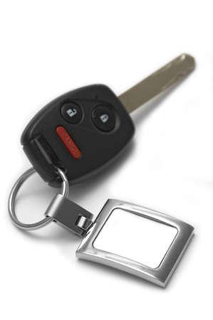 panic button: Auto chiave con telecomando wireless e panico pulsante pulsante che mostra una vuota etichetta per la personalizzazione di testo - profondit� di campo!  Archivio Fotografico