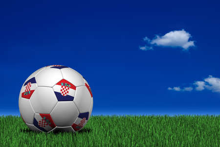 Croatian soccer ball laying on the grass photo