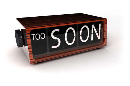 Conceptual image of a vintage alarm clock showing that it is too soon photo