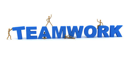 Wooden mannequins posing in front of the word Teamwork photo