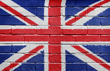 Flag of the United Kingdom painted onto a grunge brick wall photo
