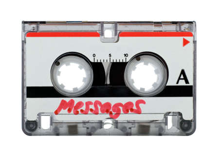 answering: Cassette tape from answering machine over white background