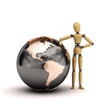Wooden mannequin leaning against a big world globe showing North and South America