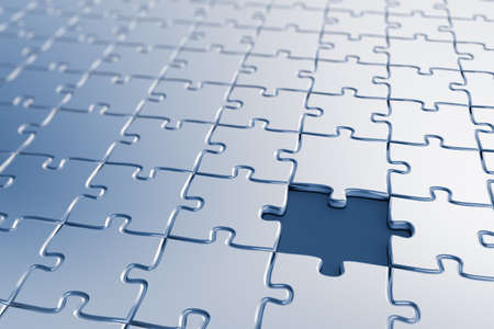 Blank puzzle with a missing piece - shallow depth of field Stock Photo