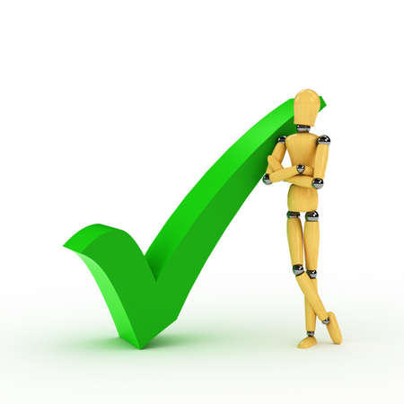 Wooden mannequin leaning against a check mark over white Stock Photo - 7944419