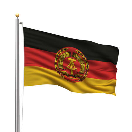 Flag of Eastern Germany with flag pole waving in the wind over white background photo