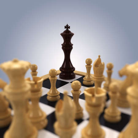 chess king: A black chess king is pushed into the corner by all white chess pieces