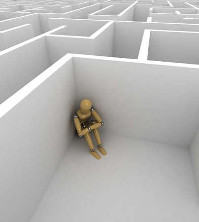 Mannequin déprimé assis dans le coin d'un grand labyrinthe Banque d'images - 8923330