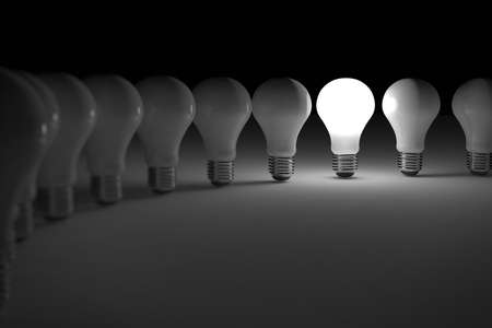 individuality: One lit light bulb amongst other broken light bulbs Stock Photo