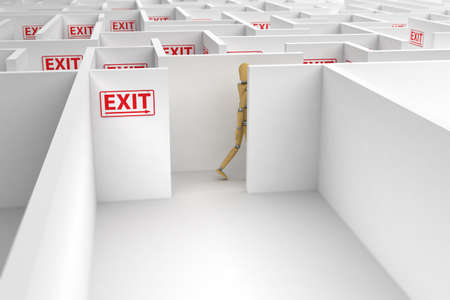 Mannequin following exit signs out of a complicated maze Stock Photo - 9038096