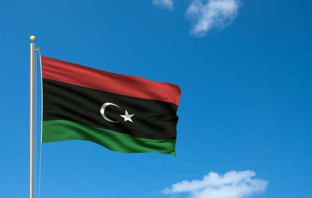 libyan: Flag of the Kingdom of Libya waving in the wind in front of blue sky